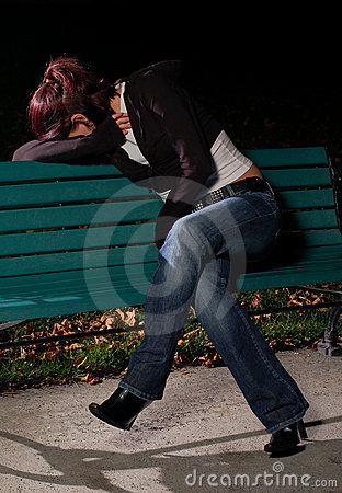 Crying girl on a park bench 2