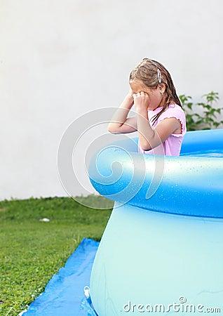 Crying girl in pool
