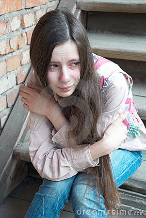 Crying girl on stairs