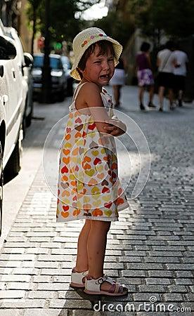 Crying girl on street