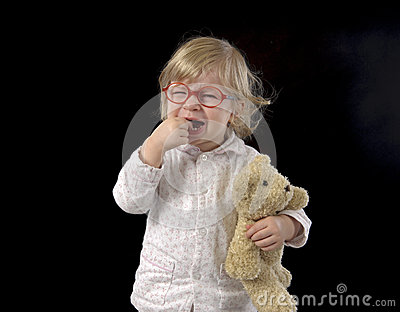 Crying little toddler in pajama Stock Photo