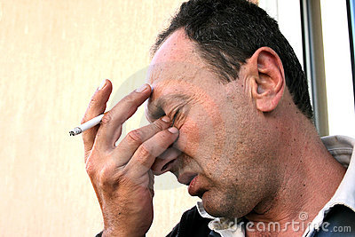 Crying man with cigarette