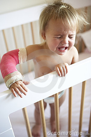 Crying Toddler With Arm In Cast