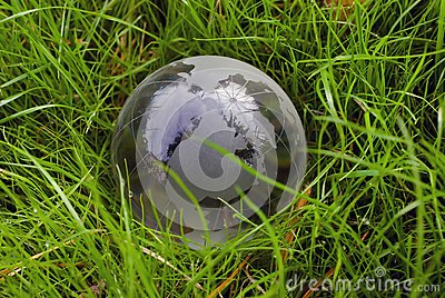 Crystal-clear globe in the green grass