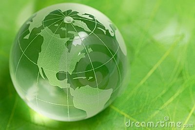 Crystal globe on green leaf