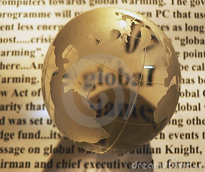 Crystal globe on newspaper
