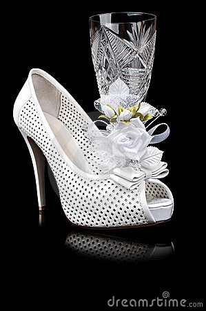 Crystal goblet and wedding shoe