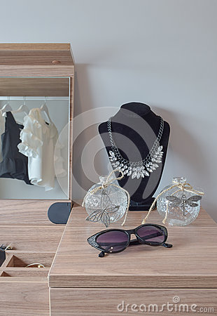 Free Crystal Jars And Necklace On Wooden Dressing Table Royalty Free Stock Photos - 86141888