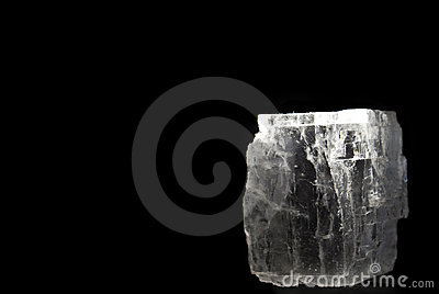 Crystal of rock salt on black