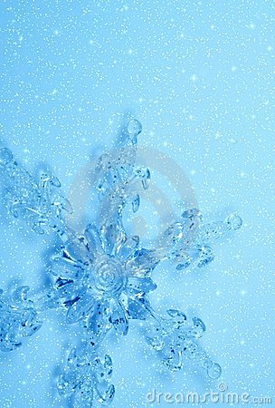 Crystal snowflake in snow