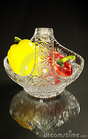 Crystal vase and peppers