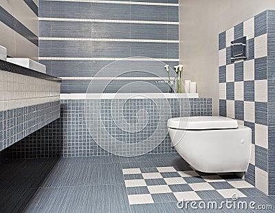 Cuarto de baño moderno en tonos azules y grises con el tocador