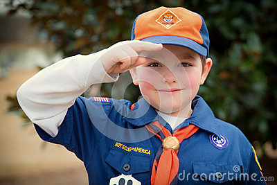 Cub Scout giving Boy Scout salute Editorial Image