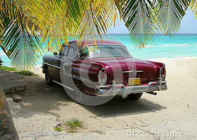 Cuba Beach classic car and palms