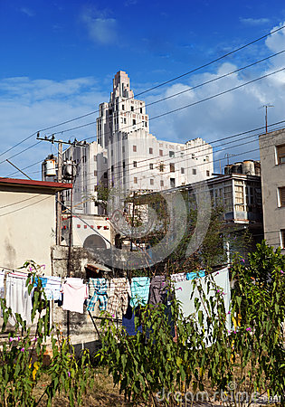 Cuba. Contrasts of old Havana - high-rise buildings and linen drying in the forefront in yard