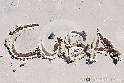 Cuba handwritten on the white sand