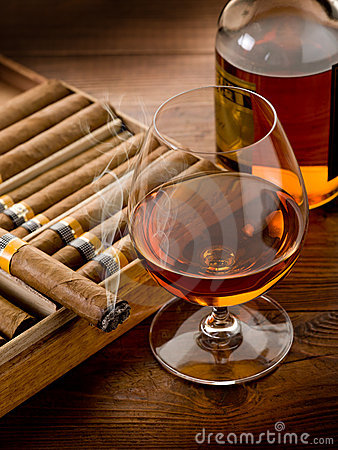 Free Cuban Cigar And Bottle Of Cognac Royalty Free Stock Photography - 20924317