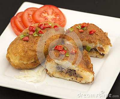 Cuban cuisine traditional stuffed potatoes stock photo for Authentic cuban cuisine