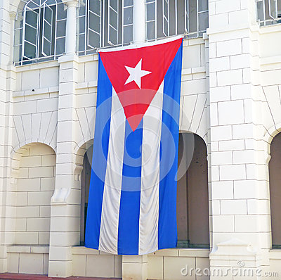 Cuban flag hangs from the Museo de la Revolucion