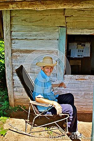 Cuban farmer in rocking chair Editorial Stock Image