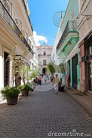 Cubans walking down a street in Havana Editorial Stock Image