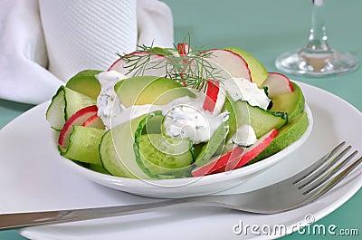 Cucumber salad with radish and avocado cream sauce