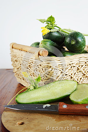 Cucumbers with a cutting board