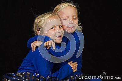 Cuddling twins twins