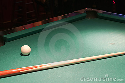 Cue ball and stick on pool table