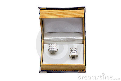 Cuff links in a case on the white