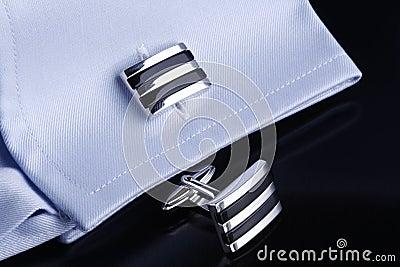 Cufflinks on blue shirt