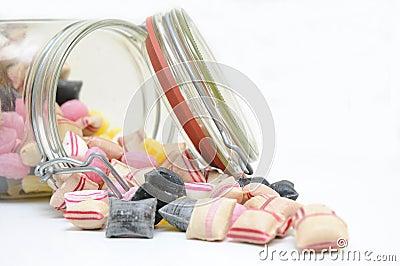 Cukierki folujący szklany słój
