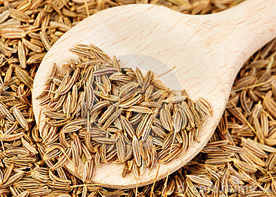 Cumin seeds and wooden spoon