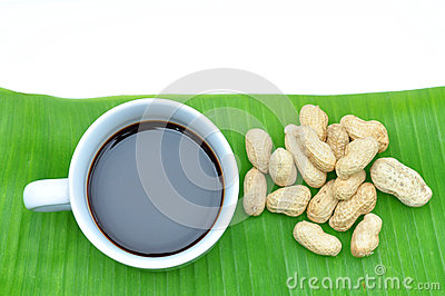 A cup of black coffee on banana leaf