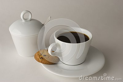 Cup of black coffee with cookies