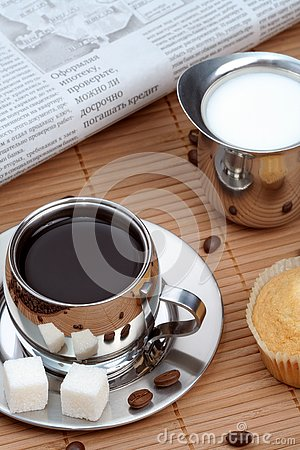 Cup of black coffee with muffin and milk