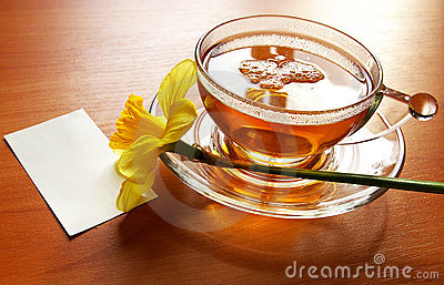 Cup of black tea and  flowers