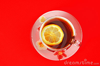 Cup of black tea with a lemon