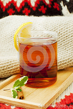 A cup of black tea with lemon