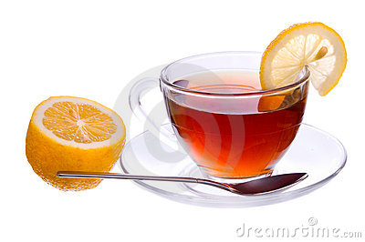A cup of black tea with lemon and spoon