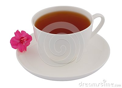 Cup of black tea with pink flower
