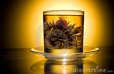 Cup with blooming flower tea