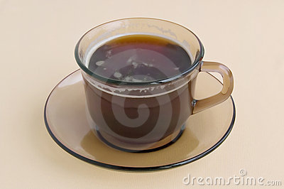 A cup of brown glass with coffee