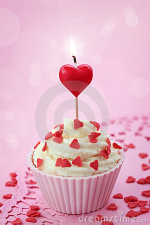 Cup cake with heart candle