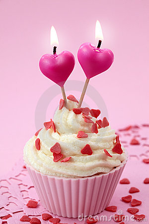 Cup cake with heart candles