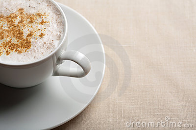 Cup of cappuccino over linen background