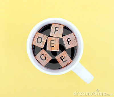 Cup of coffee with alphabet