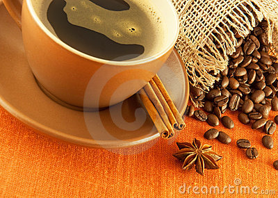 Cup of coffee and bag of grains