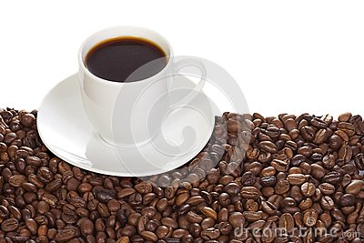 Cup with coffee and beans