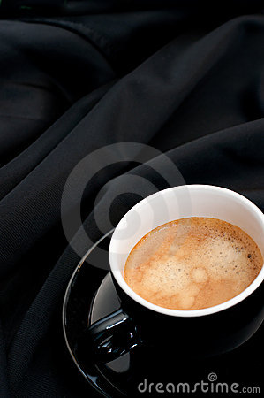 Cup of Coffee on Black Drapery